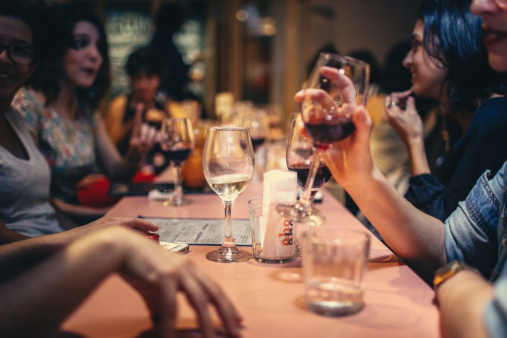 Photo of people drinking wine